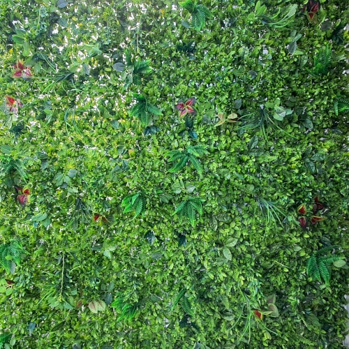 Lush greenery photo booth backdrop with varying green and red leaves
